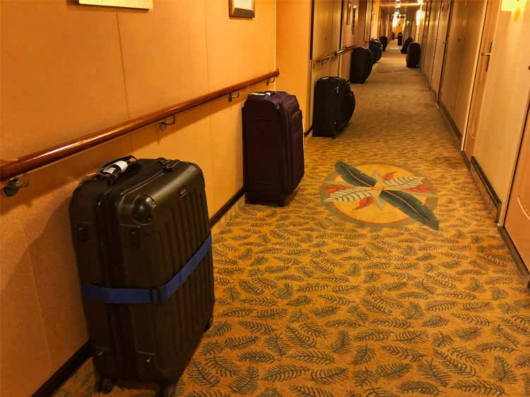 Cruise ship hallway with luggage