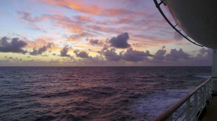Taking photos of sunsets on cruises